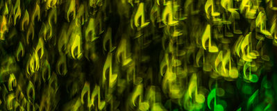 Night lights bokeh shaped sheet music, defocused bokeh light, bl Stock Photos