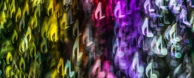 Night lights bokeh shaped sheet music, defocused bokeh light, bl Royalty Free Stock Image
