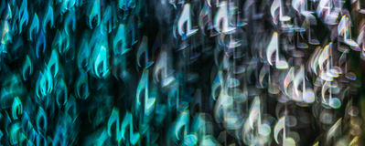Night lights bokeh shaped sheet music, defocused bokeh light, bl Royalty Free Stock Photography