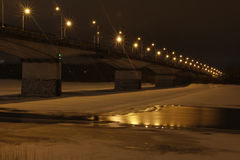 Night lights on the bridge and snow Royalty Free Stock Photos