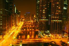 Night lights on the Chicago River. City lights glow over the Chicago River at night in Chicago Illinois Stock Image