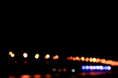 Night lights. Of city over river, dark background Stock Photos