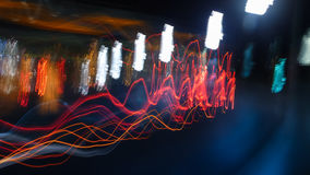 Night Lights. Colored lights seen at evening and during night with motion blur caused by bypassing cars / traffic and free hand hold camera, creating waves of Royalty Free Stock Photos