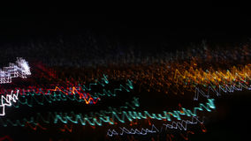 Night Lights. Colored lights seen at evening and during night with motion blur caused by bypassing cars / traffic and free hand hold camera, creating waves of Royalty Free Stock Images
