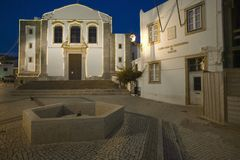Night lights come on at dusk in Cascais, north of Lisbon/Lisboa Portugal Stock Images