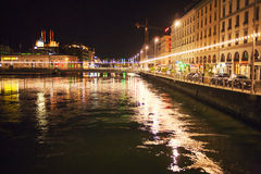 Night lights in Geneve. Lighted Geneve city and Rhone river at night Royalty Free Stock Photo
