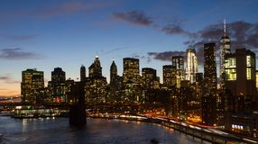 New York City Skyline Lights at Dusk. Night lights of the New York City skyline at dusk in Manhattan, NYC Stock Images