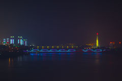 Night lights in Pyongyang, North Korea. Fog and rain over the ri Stock Image