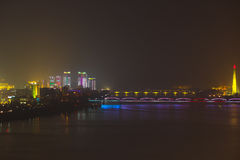 Night lights in Pyongyang, North Korea. Fog and rain over the ri Royalty Free Stock Photography