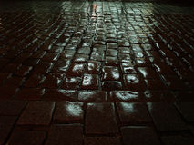 Night lights reflected in wet pavement Royalty Free Stock Images