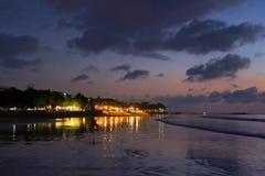 Night lights reflection after sunset at Kuta beach, Bali, Indonesia Royalty Free Stock Photos