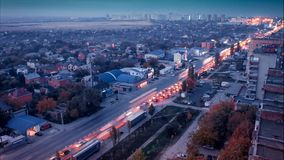 Time lapse. Fog over the city of Rostov on Don at night when cars leave a trail of lights. The view from the roof