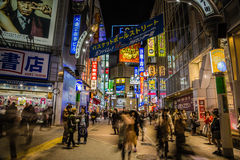 Night Lights of Shibuya // Tokyo. Foot traffic moving through Tokyo streets at night Royalty Free Stock Images