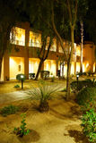 Night lights of Southwestern style hotel buildings. RANCHO MIRAGE, CALIFORNIA - DEC 16, 2015 - Night lights of Southwestern style hotel buildings in green oasis stock image