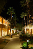 Night lights of Southwestern style hotel buildings. RANCHO MIRAGE, CALIFORNIA - DEC 16, 2015 - Night lights of Southwestern style hotel buildings in green oasis royalty free stock photography