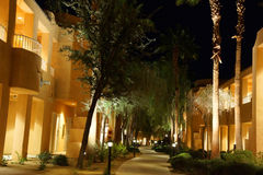 Night lights of Southwestern style hotel buildings. RANCHO MIRAGE, CALIFORNIA - DEC 16, 2015 - Night lights of Southwestern style hotel buildings in green oasis royalty free stock image
