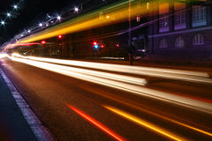 Night lights on street. Beams of light made by city traffic in the night stock image