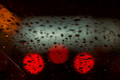 Night lights of urban traffic seen through the windshield in rainy weather. Abstract background. Concept of night city Royalty Free Stock Photo