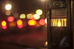 Wait. A night lit perspective of londons city life Royalty Free Stock Photography