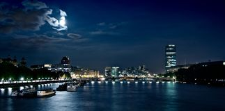 Night in London. Dark Thames stock photography