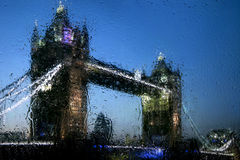 By-night London through the glass Royalty Free Stock Images