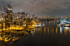 Night long exposure city shot with city lights and port Royalty Free Stock Image