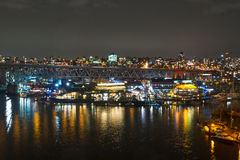 Night long exposure city shot with city lights and port Stock Images