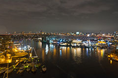 Night long exposure city shot with city lights and port Royalty Free Stock Photography