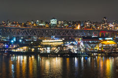 Night long exposure city shot with city lights and port Royalty Free Stock Photos