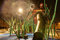Night long exposure HDR image of a child playground with various decorative sea creatures and twisted metals and pipes Royalty Free Stock Photo