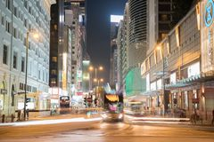 Night long exposure of passing vehicles on busy city street. Royalty Free Stock Image
