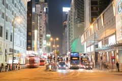 Night long exposure of passing vehicles on busy city street. Royalty Free Stock Photography