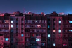 Night long exposure photo 9 and 10 floors high-rise buildings in red and blue colours. Big city life is here royalty free stock images