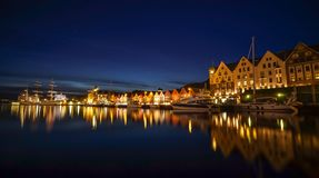 A night long exposure photography of Bergen at harbor with beautiful water reflection royalty free stock photo
