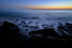 Night long exposure of the rocky atlantic coast in the west part of Gran Canaria island stock photography