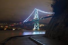 Night long exposure shot of bridge with glowing lights Royalty Free Stock Photo