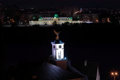 Night long exposure shot of a wind wane in a shape of an angel. With a trumpet at a top Nizhny Novgorod Theological Seminary. A scenic view of Nizhny Novgorod royalty free stock image