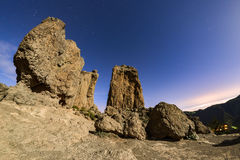 Night long exposure view of the Roque Nublo peak on Gran Canaria island, Spain Stock Photos