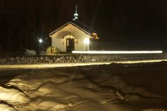 . night. a lot of snow. Country Church as a lighthouse at sunset. there dvezhenie car gleam royalty free stock images
