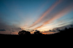 Night macro. Beautiful sunset with silhouette and ray Royalty Free Stock Photography