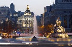 Night Madrid. Madrid, Spain - March 22, 2012: heavy traffic in the historic center of Madrid, highlights the Metropolis building and the Cibeles fountain, two of Royalty Free Stock Image