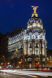 Night in Madrid. The Gran Via in the night at Madrid city, Spain in vertical frame Royalty Free Stock Image