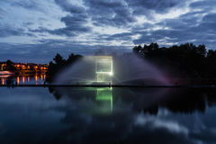 Night magic show of fountains on the central waterfront Roshen. Ukrainian city of Vinnitsa Stock Images