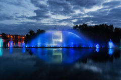 Night magic show of fountains on the central waterfront Roshen. Ukrainian city of Vinnitsa Stock Photography
