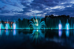 Night magic show of fountains on the central waterfront Roshen. Ukrainian city of Vinnitsa Stock Photo