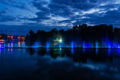 Night magic show of fountains on the central waterfront Roshen. Ukrainian city of Vinnitsa Royalty Free Stock Images