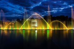 Night magic show of fountains on the central waterfront Roshen. Ukrainian city of Vinnitsa Royalty Free Stock Photos