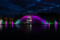 Night magic show of fountains on the central waterfront Roshen. Ukrainian city of Vinnitsa Stock Image