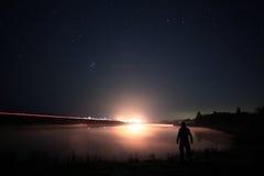 Night man at Lake Stock Images