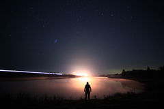 Night man at Lake Stock Image